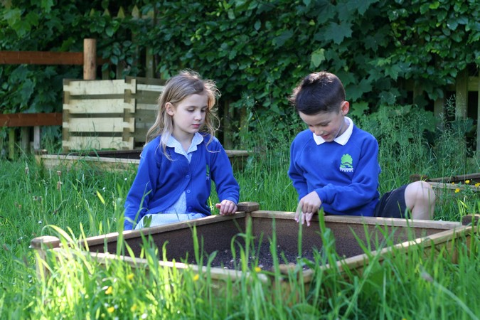 "<div class='slide-overlay orange-slide'><h2>""We're planting vegetables <br />in the new allotments""</h2></div>"